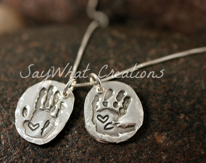 Your baby or child's ACTUAL hand prints made into silver pendants Includes TWO hand print charms with stamped initial and heart