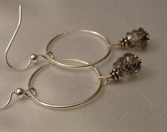uncomplicated sterling silver hoops with rutilated quartz dangles.
