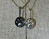 Shiny Silver Paw Pendant-50% of sale goes to a non profit