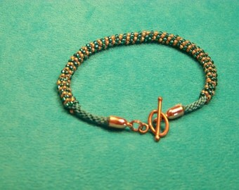 Kumihimo Bracelet - Green Braid Adorned with  Green and Bronze Seed Beads