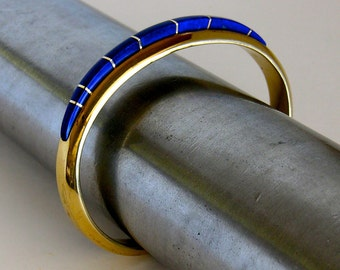 A Large Cuff Style Bracelet of Solid 14k Gold and Inlaid with Lapis and Opal