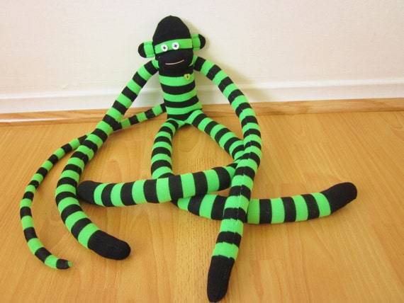 Lucky knee sock monkey plush with green and black stripes - St Patrick's Day