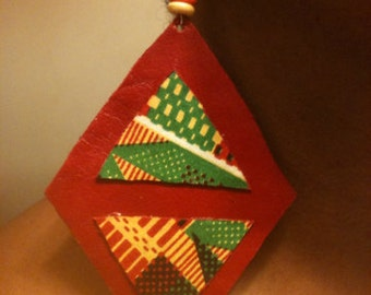 Leather earrings, with kente fabric in a diamond design.