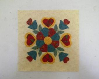 Hand Appliqued quilt block in Pennsylvania dutch style