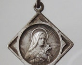 Saint Theresa Vintage Religious Medal on 18 inch sterling silver rolo chain