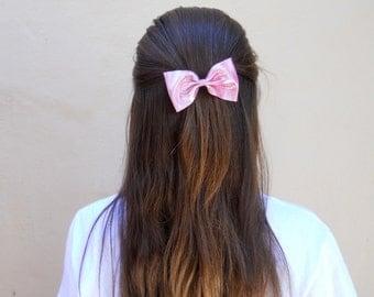 Shimmery pink bow barrette