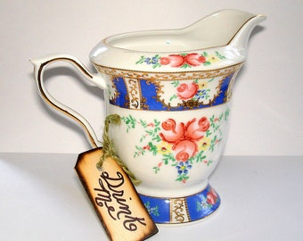 "Sorelle Creamer with ""Drink Me""  Tag  Vintage Porcelain Hand Painted Gold Gilt Blue Red Floral REDUCED PRICE"