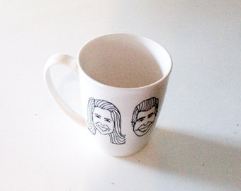 custom caricature coffee mug - two hand drawn, black and white portraits - pair of caricatures with personalized text - initials - one cup