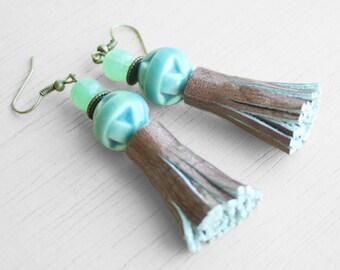 Leather tassel oriental earrings