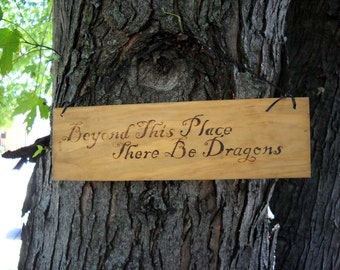 Beyond this place there be dragons wood burned plaque