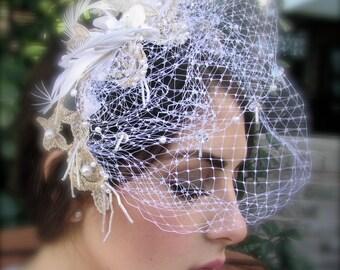 Vintage inspired bridal fascinator with veil