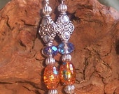 Silver and orange dangle earrings
