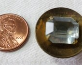 "Vintage button, gold toned metal, dish shape, central clear square facet cut stone, claw set. 0.75"" ins across. UNK13.11-20.27."