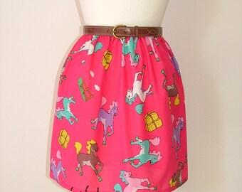Handmade high waisted skirt made with pink cartoon horse running pony shoe fabric