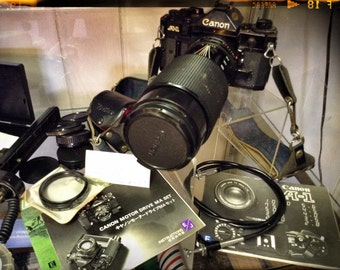 Vintage Cannon A-1 35mm SLR Camera and all it's accessories