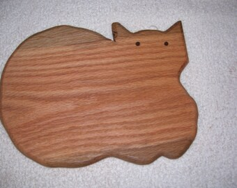 cat cutting board  made from  oak