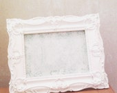 White Victorian style frame