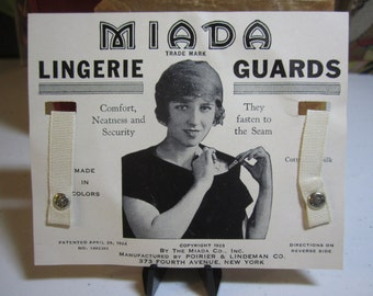 1920's art deco  unused Miada lingerie guards on original card with image of flapper