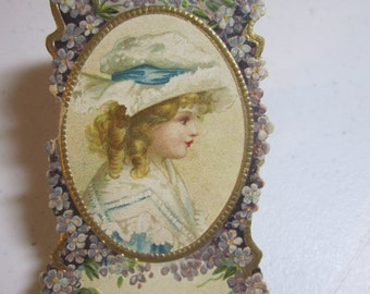 Antique die cut embossed gold gilded advertising perfume card for Jennings Perfumery co. Lovely profile of maiden surrounded by violets
