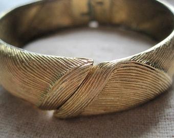 Pretty Vintage Monet Brushed & Swirled Gold Tone Clamper Bracelet