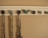 jewelry organizer w/ iron bird center w/ 7 knobs on off white with champagne embossed background  20""