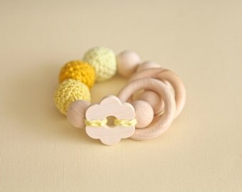 Big flower toy. Teething wooden rattle with yellow crochet wooden beads and 2 wooden rings. Baby shower gift