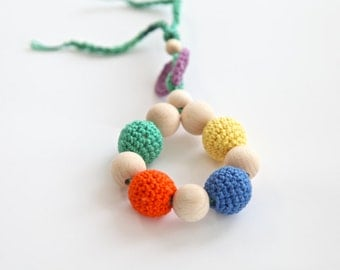 Teething toy with crochet wooden beads. Orange, blue, yellow, green