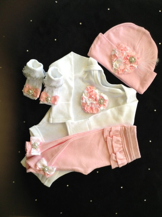 Newborn baby girl take home outfit complete with pink heart bodysuit