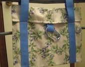 Lovely  Ladies  Walker Bag with Blue Rose Pattern. Measures 12 inches wide and 10 inches long.