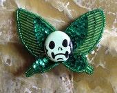 Butterfly grumpy skull brooch