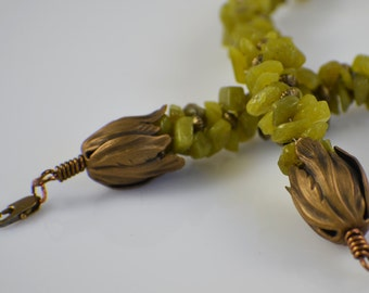 Green serpentine kumihimo necklace with brass tulip cord ends and brass accents