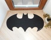 Rug based in a Batman logo. Shape doormat. Custom door mat logo.