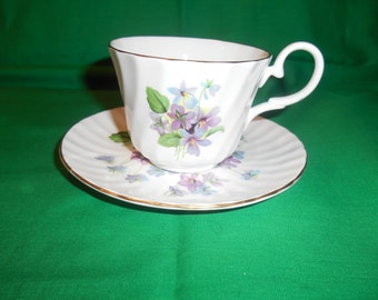 One (1), Bone China, Footed, Tea Cup and Saucer, from Royal Garden, in a Violets Pattern.