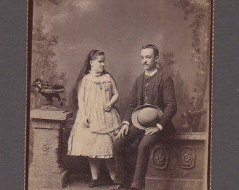 Oddly Posed Cabinet Card of a Man and Girl