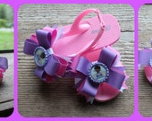 Doc Mcstuffins flip flops with bows on pink shoes with 2 mathcing bows.