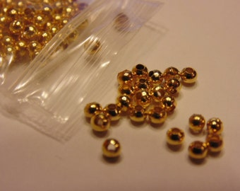 100 gold plated round spacer beads, 2.4 mm