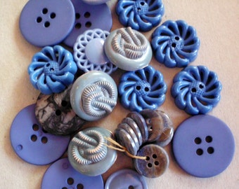 Lot of more than thirty mixed size/style blue plastic buttons