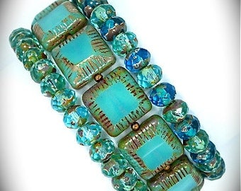 Turquoise Picasso carved beads and turquoise rondell stretch bracelets
