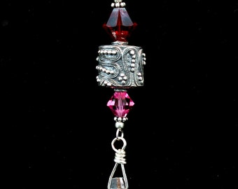 Bali Silver pendant with ruby red bicone and crystal teardrop Swarovski crystal.