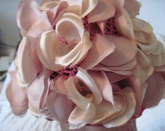 Soft, pink flowered hat from the 1950's