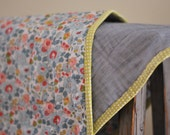 Quilted baby blanket in Liberty fabric