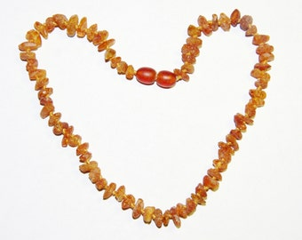 Raw unpolished Baltic amber baby necklace, cognac color beads 12v