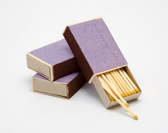 Three matchboxes, wooden matches with yellow heads inside, striker from two sides