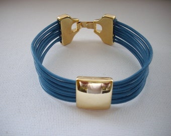 Cobalt Blue Multi Strand Leather with Gold Square Slider Bead and Gold Clasp