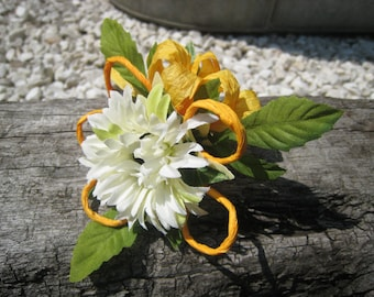 Ivory Daisy corsage with Orange Bows.
