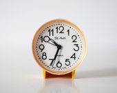 Vintage yellow mechanical alarm clock SLAVA