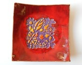 red plate, serving plate, flowers pattern, orginal desing, red yellow and violet glaze, ceramic plate, plate with texture, colourfull