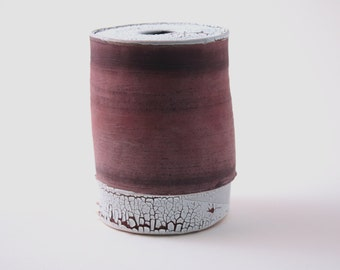 Handthrown earthenware vessel with unique texture and powder effect in red color