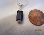 Interesting Iolite and Sapphire Pendant