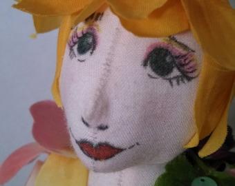Flower is a flower fairy soft sculpture doll  Handmade